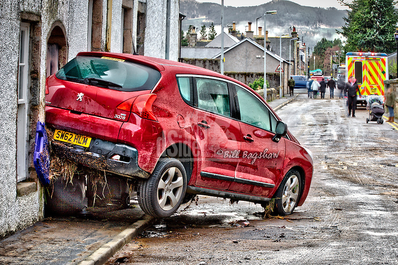 Washed up car Ballater floods, with wheely bins trapped underneath by flooding (Bill Bagshaw/M. Williams)