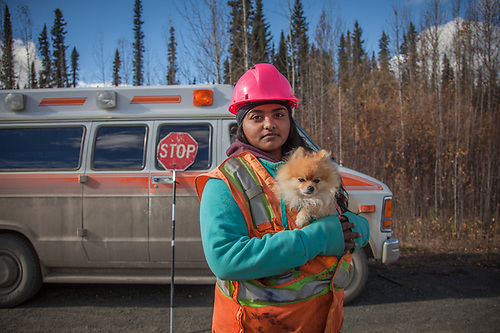 Flagger Love Deol and her dog Bosley on the Alaska Highway in the Yukon Territory on the second day of Clark and Mitzi's move from Anchorage, Alaska to Calistoga, California, September, 2015  lovieheera@hotmail.com (© Clark James Mishler)
