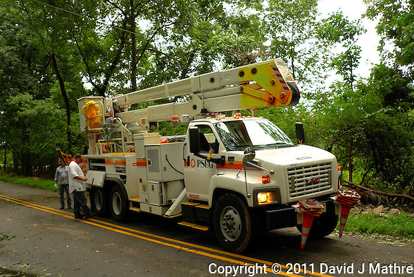 PSE&G Truck and Crew Getting Set Up oo Repair the Downed Power Line. Hurricane Irene. Image taken with a Leica X1 camera. (David J Mathre)