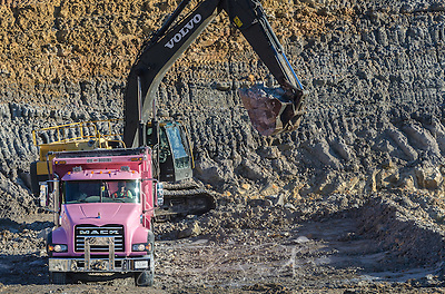An employee with KR Trucking loads kaolin clay into a 2015 Mack Granite dump truck, Sept. 20, 2016, in Huntingdon, Tennessee. The company, which mines both kaolin and ball clay, uses primarily Mack Granites in its fleet. (Photo by Carmen K. Sisson/Cloudybright) (Carmen K. Sisson/Cloudybright)