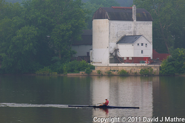 Rower in the mist. Delaware River between Lambertville and New Hope. Image taken with a Nikon D3x and 105 mm f/2.8 VR macro lens + TC-E III 20 teleconverter (ISO 100, 210 mm, f/9, 1/125 sec). Raw image processed with Capture One Pro 6 and Photoshop CS5. (David J Mathre)