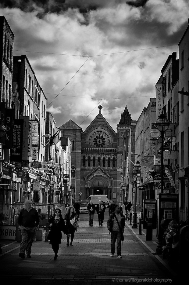 People walking on South Ann Street, Just off Grafton Street in Dublin, with a Moody sky overhead. (Thomas Fitzgerald)
