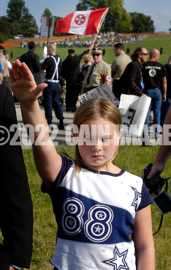 VALLEY FORGE, PA - SEPTEMBER 25: A young member of the Ku Klux Klan salutes during American Nazi Party rally at Valley Forge National Park September 25, 2004 in Valley Forge, Pennsylvania. Hundreds of American Nazis from around the country were expected to attend. (Photo by William Thomas Cain/Getty Images) (William Thomas Cain/Getty Images)