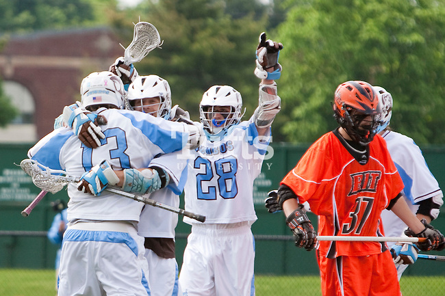 05/16/2012 - Medford, Mass. - Tufts midfielder Geordie Shafer (8), A12, is hugged by his teammates Tufts attackman Sean Kirwan (13), A12, and Tufts attackman Cole Bailey (28), A15, after scoring in Tufts 15-13 win over RIT in the NCAA Championship quarterfinal at Bello Field on May 16, 2012.  (Kelvin Ma/Tufts University) (Kelvin Ma/Tufts University)