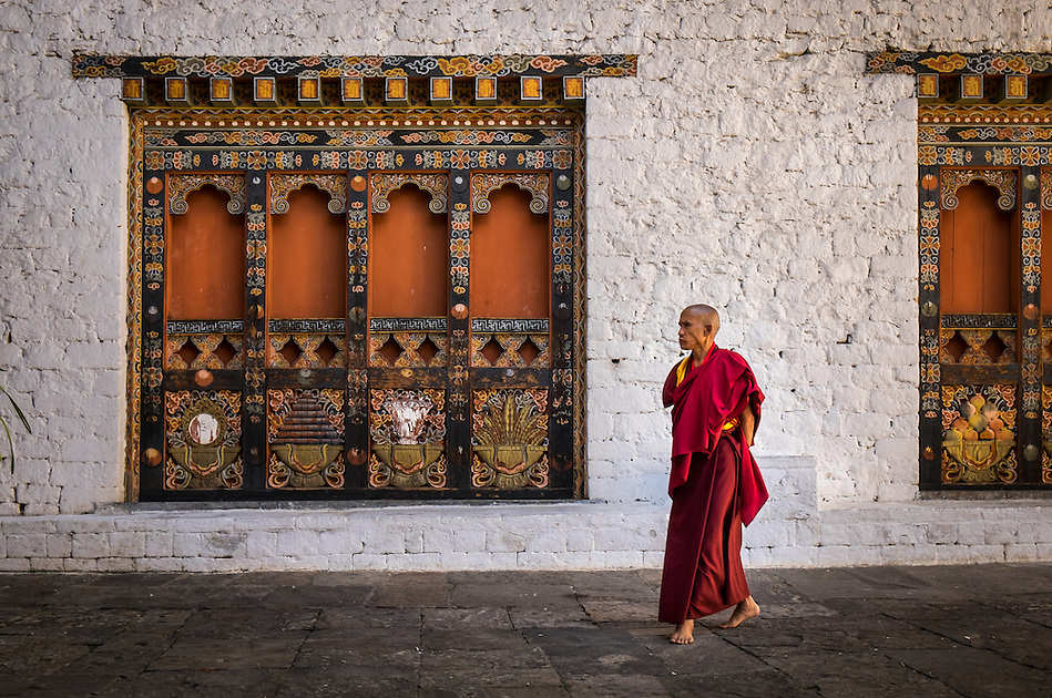 PUNAKHA, BHUTAN - CIRCA October 2014: Monk walking in the Punakha Dzong, a landmark in Punakha, Bhutan (Daniel Korzeniewski)