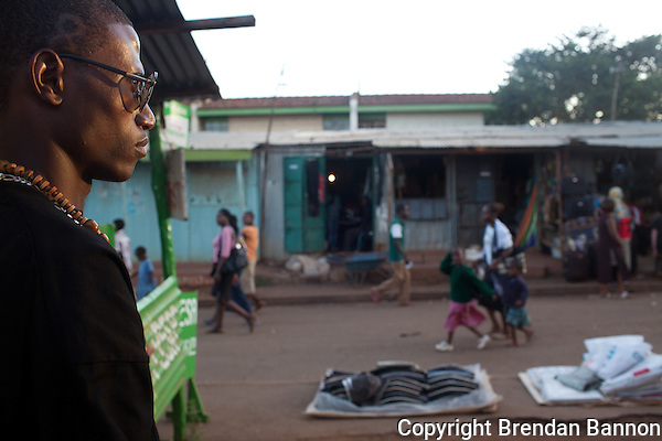 23-year-old hip-hop artist Octopizzo keeps his eye on the street in Kibera. (Photographer: Brendan Bannon)