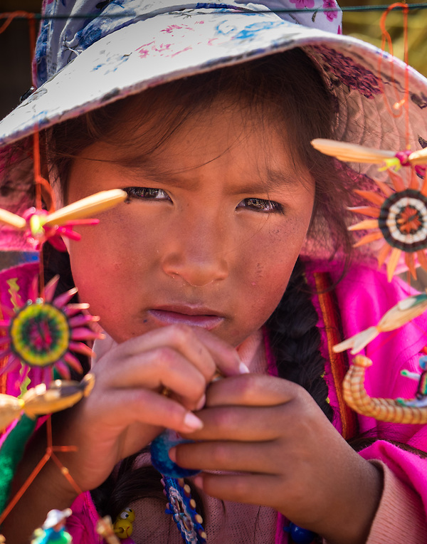UROS ISLANDS, PERU - CIRCA APRIL 2014: Girl from the Uros Islands in Lake Titicaca. (Daniel Korzeniewski)