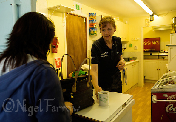 17 MAY 2015 - IPSWICH, GBR - Development and Cafe Manager Helen Clancy serves a customer during the Elite League fixture against Horspath Hammers at Whitton Sports and Community Centre in Ipswich, Suffolk, Great Britain (PHOTO COPYRIGHT © 2015 NIGEL FARROW, ALL RIGHTS RESERVED) (NIGEL FARROW/COPYRIGHT © 2015 NIGEL FARROW : www.nigelfarrow.com)