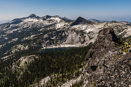 A hiker's view just a few feet from the top of Harrison Peak in North Idaho's Selkirk Range.  Harrison Lake is seen below. (Benjamin Chase)