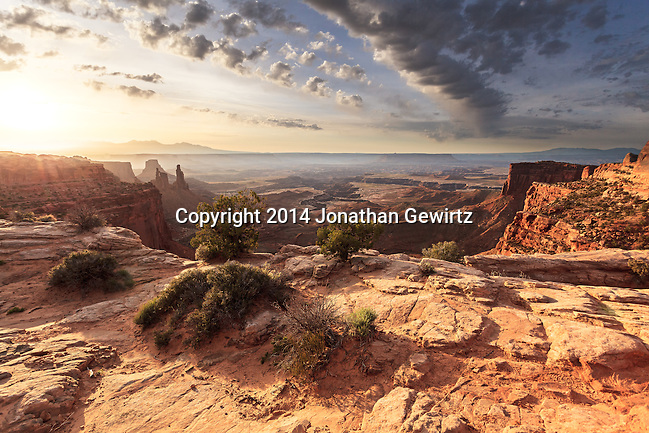 Early morning view from the top of Mesa Arch to the surrounding desert lowlands, Canyonlands National Park, Utah. (© 2014 Jonathan Gewirtz / jonathan@gewirtz.net)