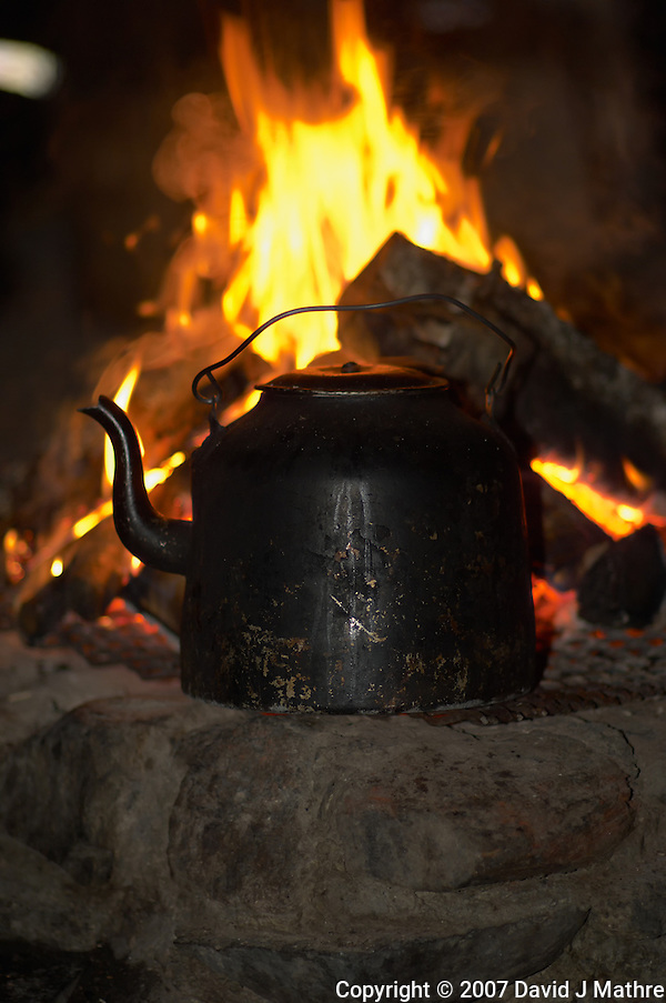 Coffee Warming By a Wood Fire. Image taken with a Nikon D2xs and 85 mm f/1.4 lens (ISO 200, 85 mm, f/1.4, 1/60 sec). (David J Mathre)