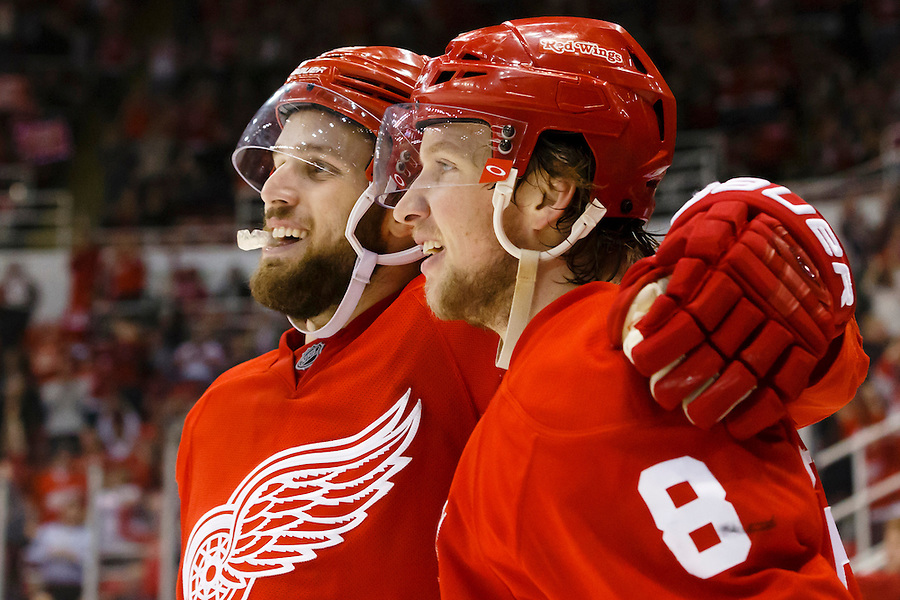 Mar 9, 2015; Detroit, MI, USA; Detroit Red Wings left wing Justin Abdelkader (8) receives congratulations from center Riley Sheahan (15) after scoring an open net goal in the third period against the Edmonton Oilers at Joe Louis Arena. Detroit won 5-2. Mandatory Credit: Rick Osentoski-USA TODAY Sports (Rick Osentoski/Rick Osentoski-USA TODAY Sports)