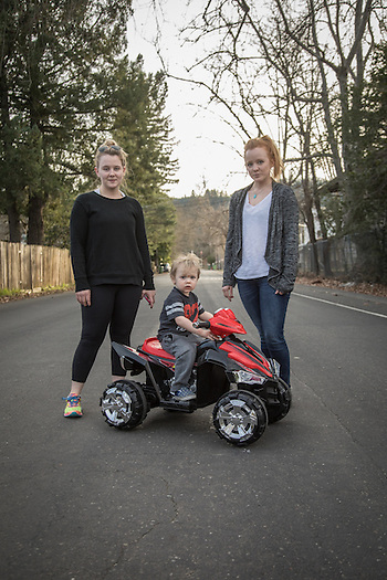 """I'm happy it only goes 2.5 mph...I can catch him.""  -Courtney Stockton (right) with her two year old son, Theo, and friend, Jordan VanDine on North Oak Street in Calistoga (Clark James Mishler)"