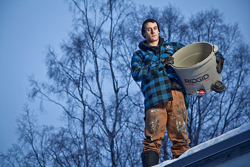 Weatherization Specialist, Chris Robinson, on the roof of a home in Anchorage's South Addition. (Clark James Mishler)