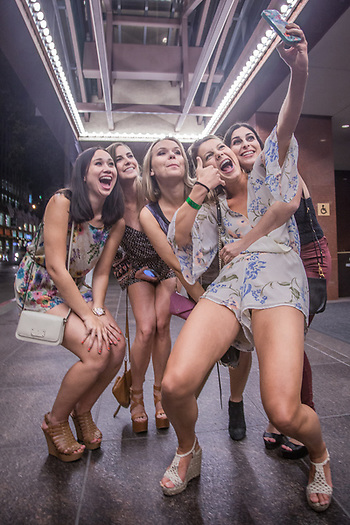 Communications student Elisa Pedder and her UC Davis classmates make a selfie in front of the Marriott prior to a night on the town on Mission Street in San Francisco, California  erpedder@ucdavis.edu (© Clark James Mishler)