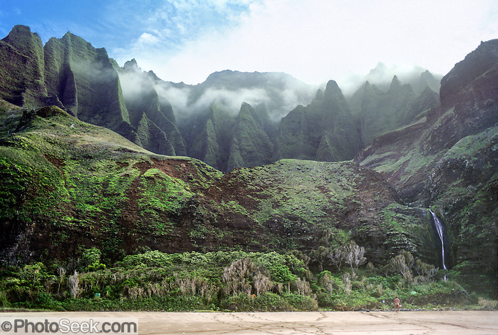 Sea cliffs rise spectacularly up to four thousand feet above Kalalau Beach on the Na Pali Coast, Kauai, state of Hawaii, USA. Copyright Tom Dempsey / PhotoSeek.com