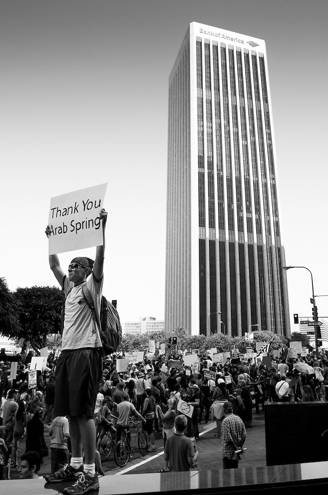 Occupy Los Angeles protesters participate in the global day of protest in demonstration against corporate greed by marching through the financial district. (Todd Bigelow)
