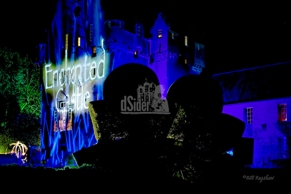 Crathes Castle is bathed in light by stunning projections, during the annual Enchanted Castle sound and light event. The famous Crathes shaped hedges can be seen in the foreground. www.dsider.co.uk online magazine, photo courses Photography by Bill Bagshaw (Bill Bagshaw & Martin Williams/Bill Bagshaw, www.dsider.co.uk)
