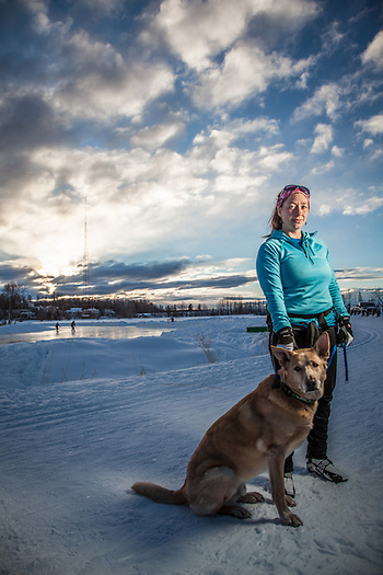 Guide and ski coach, Erin Popek, with her dog at Westchester Lagoon, Anchorage (Clark James Mishler)