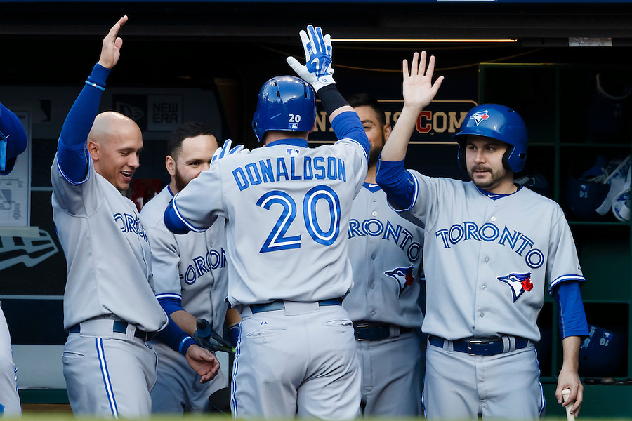 May 1, 2015; Cleveland, OH, USA; Toronto Blue Jays third baseman Josh Donaldson (20) receives congratulations from teammates after he hits a home run in the first inning against the Cleveland Indians at Progressive Field. Mandatory Credit: Rick Osentoski-USA TODAY Sports (Rick Osentoski/Rick Osentoski-USA TODAY Sports)