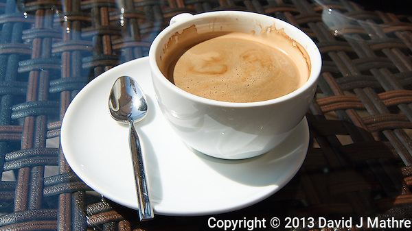 Coffee Americano at an Outdoor Cafe in Riga, Latvia. Image taken with a Nikon 1 V2 camera and 10-100 mm VR lens (ISO 160, 16 mm, f/5.6, 1/1000 sec). Semester at Sea Spring 2013 Enrichment Voyage. (David J Mathre)