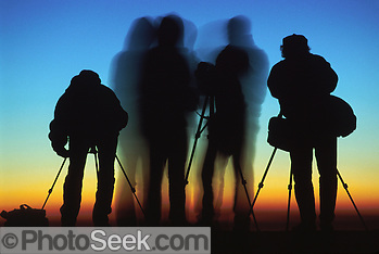 Silhouettes of photographers at sunrise on Mount Nemrut, Republic of Turkey.