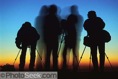 Silhouettes of four photographers at sunrise on Mount Nemrut, in the Republic of Turkey.