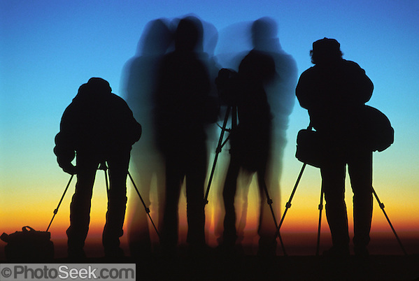 Silhouettes of four photographers at sunrise on Mount Nemrut, in the Republic of Turkey. (© 1999 Tom Dempsey / Photoseek.com)