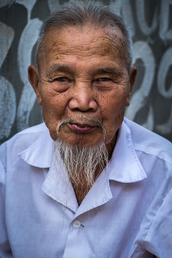 VAN HA, VIETNAM - CIRCA SEPTEMBER 2014:  Portrait of old man at the Lang Gom Tho Ha village. The village belongs to the Van Ha commune, it is located 50km away from Hanoi in Northern Vietman (Daniel Korzeniewski)