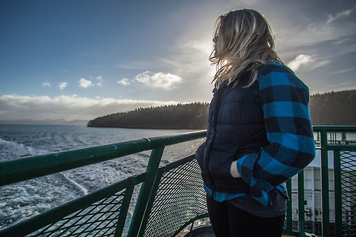 Young woman on the Washington State Ferry in route to Orcas Island. (© Clark James Mishler)