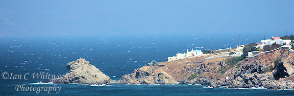 View from a Mediterranean cruise ship of a small Greek Island on route to Mykonos (Ian C Whitworth)