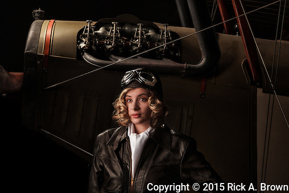 "A young model posing as a late twenties aviatrix with a Curtiss JN-4D ""Jenny"" at WAAAM. (Rick A. Brown)"