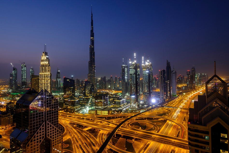 UNITED ARAB EMIRATES, DUBAI - CIRCA JANUARY 2017: Sheikh Zayed Road and Burj Khalifa at dawn in Dubai. This is the main artery of the city and is home for most of the Dubai skyscrapers. (Daniel Korzeniewski)