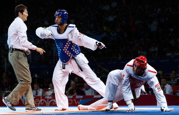 10 AUG 2012 - LONDON, GBR - Ramin Azizov (AZE) (centre) of Azerbaijan appeals to the referee during his men's -80kg category quarter final contest against Mauro Sarmiento (ITA) (right) of Italy at the London 2012 Olympic Games Taekwondo at Excel in London, Great Britain (PHOTO (C) 2012 NIGEL FARROW) (NIGEL FARROW/(C) 2012 NIGEL FARROW)