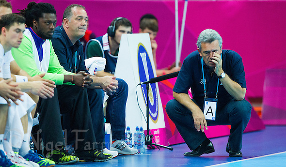 08 AUG 2012 - LONDON, GBR - Claude Onesta (FRA) (right), the head coach of France, struggles to watch his team during the men's London 2012 Olympic Games quarter final match against Spain at the Basketball Arena in the Olympic Park, in Stratford, London, Great Britain (PHOTO (C) 2012 NIGEL FARROW) (NIGEL FARROW/(C) 2012 NIGEL FARROW)