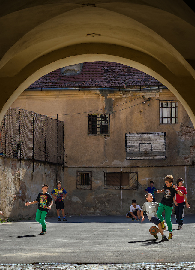 BRASOV, ROMANIA - October 2, 2012: Local kids playing soccer in the streets of Bra?ov, Romania, with 227,961 people living there is the 8th most populous city in Romania and a popular tourist destination. (Daniel Korzeniewski)