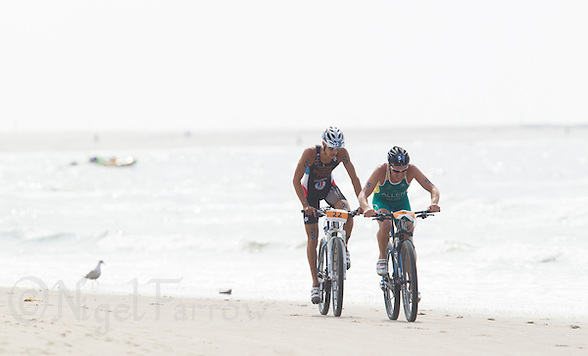 13 JUL 2013 - DEN HAAG, NED - Ben Allen (AUS) (right) of Australia leads Brice Daubord (FRA) (left) of France along the beach during the bike at the 2013 ITU Elite Men's Cross Triathlon World Championships in Kijkduin, Den Haag (The Hague), the Netherlands (PHOTO COPYRIGHT © 2013 NIGEL FARROW, ALL RIGHTS RESERVED) (NIGEL FARROW/COPYRIGHT © 2013 NIGEL FARROW : www.nigelfarrow.com)