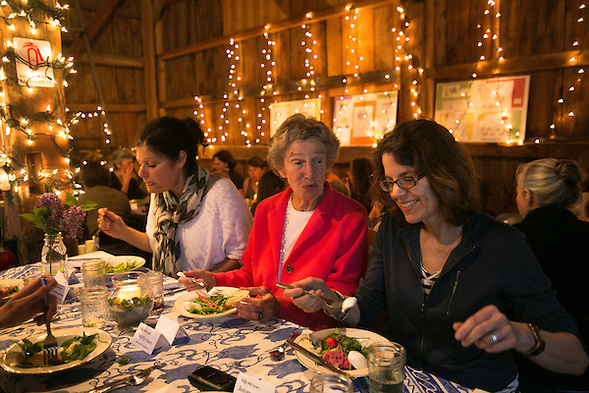 Cohasset, MA 05/11/2013.Diners, including from left Beth Baron, Mary Hartshorne, and Jenny White enjoy a farmhouse salad of shaved asparagus, wild arugula, pickled radish, and a farm fresh egg during Holly Hill Farm's farm to table dinner on Saturday evening..Alex Jones / www.alexjonesphoto.com (Alex Jones / www.alexjonesphoto.com)
