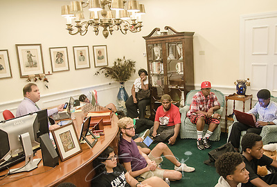 Pat Fargason  (left), communications specialist for the Florida Department of Juvenile Justice, keeps a watchful eye on a Dream Defenders meeting July 23, 2013 in Florida Gov. Rick Scott's office in the state capitol in Tallahassee. Members of the youth-led activist group moved into the capitol July 16, 2013 and have refused to leave until the governor agrees to hold a special legislative session to address issues like racial profiling, the school-to-prison pipeline, and Florida's stand-your-ground law. (Photo by Carmen K. Sisson/Cloudybright) (Carmen K. Sisson/Cloudybright)