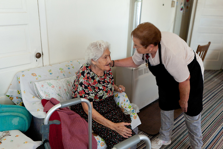 Bernis Chavez chats with a client on her route while making deliveries to Torrance County senior citizens. New Mexico has received more than $601,000 for senior meals programs around the state. (Steven St. John)