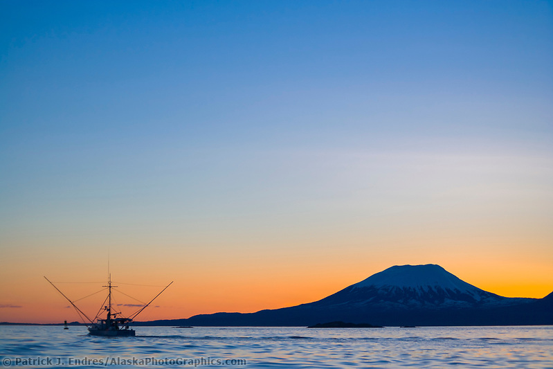 Commercial fishing trolling vessel in Sitka Sound. Sunset behind mount Edgecumbe, an inactive volcano on Kruzof Island, southeast Alaska. (Patrick J. Endres / AlaskaPhotoGraphics.com)