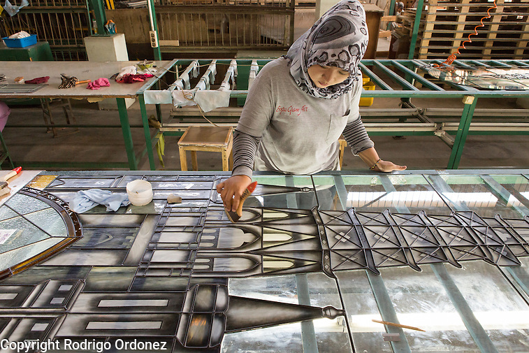 An employee applies chemical products to a stained glass window in the form of a church at the Eztu Glass factory in Tangerang, near Jakarta, Indonesia, on July 2, 2015. Indonesia is the country with the world's largest Muslim population, of about 205 million people. Roughly 88% of Indonesia's population is Muslim, and the nation is home to about 13% of the world's Muslims. (Rodrigo Ordonez)