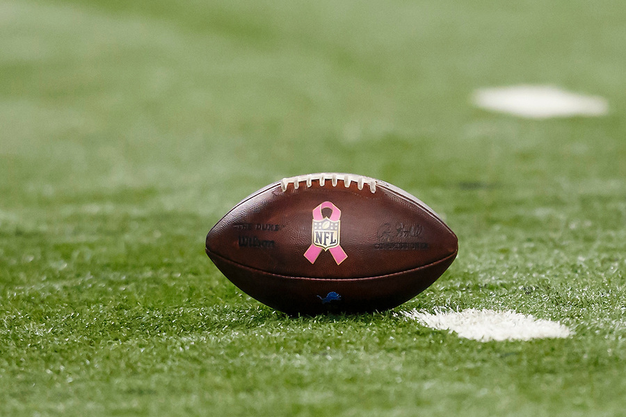 Football with pink ribbon logo for Breast Cancer Awareness is seen during an NFL football game between the Detroit Lions and the Arizona Cardinals at Ford Field in Detroit, Sunday, Oct. 11, 2015. (AP Photo/Rick Osentoski) (Rick Osentoski/AP)