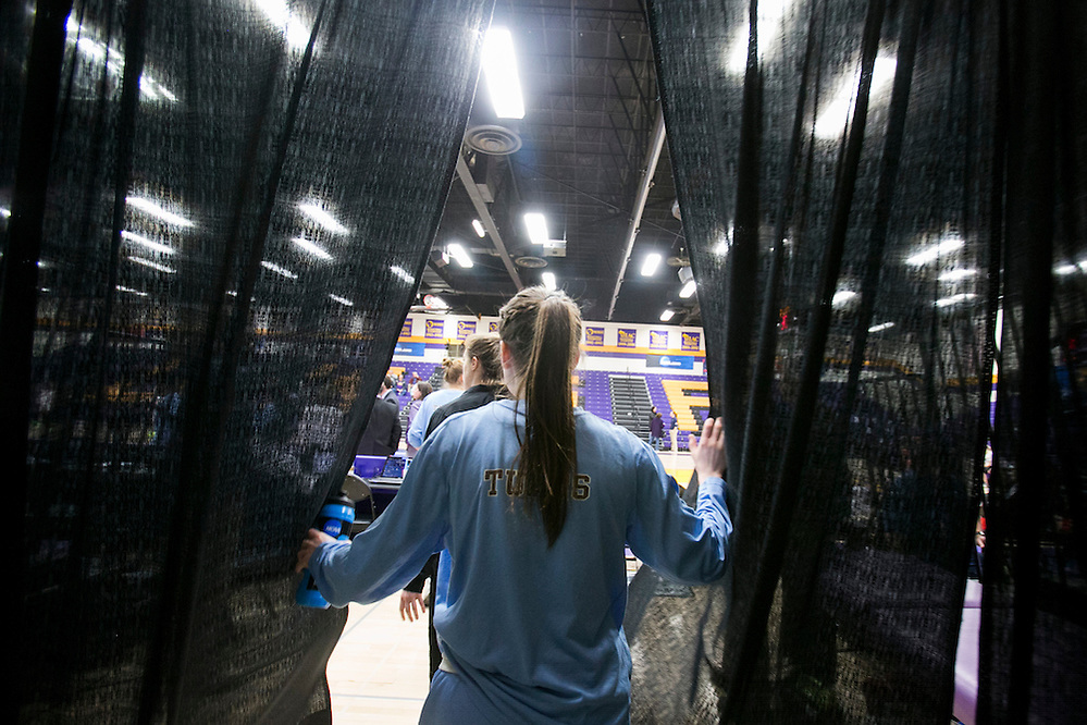 03/21/2014- Stevens Point, Wisc. -  Emma Roberson, A16, and the rest of the Tufts women's basketball game walk through the curtain into the Quandt Fieldhouse to face FDU-Florham in their NCAA Division III Women's Final Four game on Mar. 21, 2014. (Kelvin Ma/Tufts University) (Kelvin Ma/Tufts University)