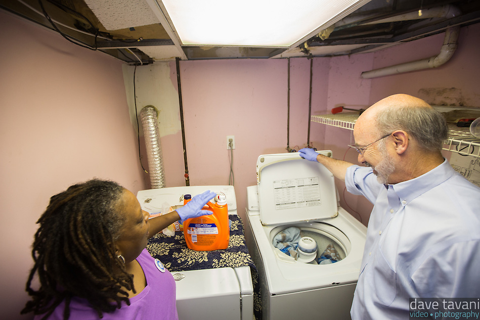 Pennsylvania gubernatorial candidate Tom Wolf walks a day in the shoes of home health care worker Aretha Spady as she cares for her client Leroy Evans in the West Oak Lane section of Philadelphia on October 3, 2014. Wolf helped Spady with tasks such as cleaning and making Mr. Evans' bed, doing laundry, washing dishes, taking Mr. Evans for a walk, and sweeping up the floors. Wolf and Spady held a short press conference about the role of home health workers. (Dave Tavani)