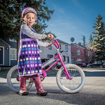 Ellie Cutting, age 6, on her bicycle on H Street, South Addition, Anchorage (Clark James Mishler)