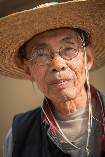 San Francisco resident Tim Guan, photographed near his home at Potero Terrace. (Clark James Mishler)