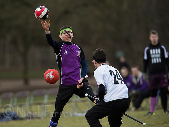 08 MAR 2015 - NOTTINGHAM, GBR - Ollie Farrell (left) from Durhamstrang attempts to pass whilst trying to avoid a bludger during the match against Leicester Thestrals at the 2015 British Quidditch Cup in Woollaton Hall and Deer Park in Nottingham, Great Britain (PHOTO COPYRIGHT © 2015 NIGEL FARROW, ALL RIGHTS RESERVED) (NIGEL FARROW/COPYRIGHT © 2015 NIGEL FARROW : www.nigelfarrow.com)