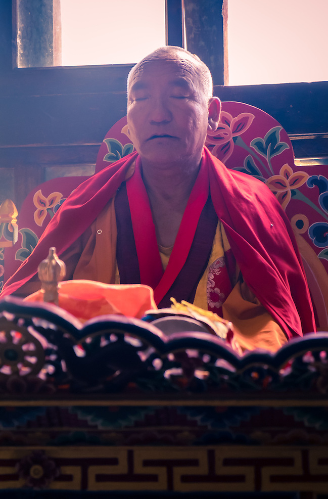 PARO, BHUTAN - CIRCA OCTOBER 2014: Bhutanese monk chanting and meditating during a ritual in Paro, Bhutan (Daniel Korzeniewski)