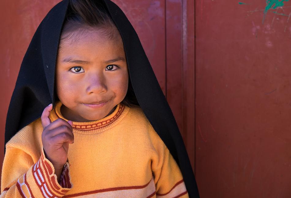 TAQUILE ISLAND, PERU - CIRCA APRIL 2014: Portrait of girl in Taquile Island, Peru. (Daniel Korzeniewski)